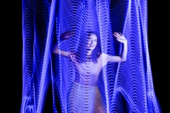 Blue lightpainting with female model trying to get out