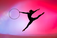 Gymnast silhouette with coloured background