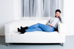Relaxed female portrait sitting on sofa