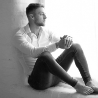 Male model sat on windowsill