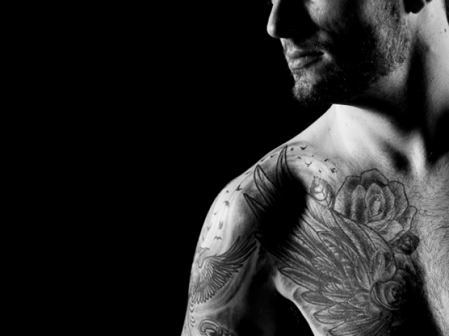 Creative portrait of man with tattoos