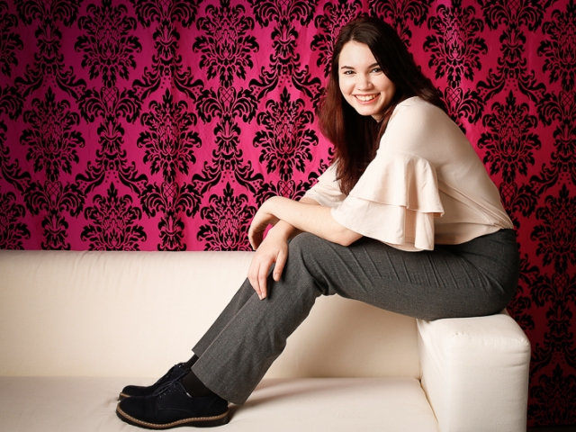Relaxed business woman sitting on sofa