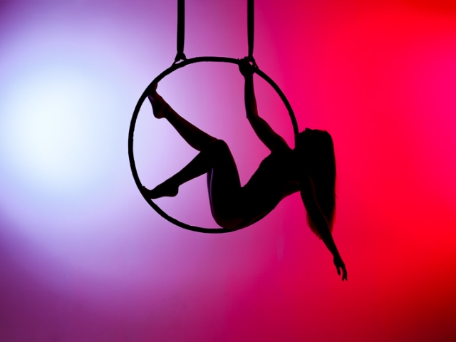 Silhouette of Aerial Hoop with coloured background