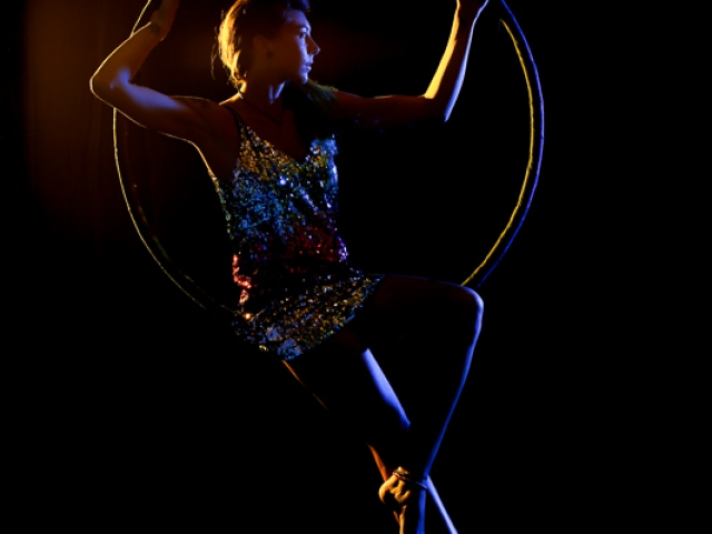 Aerial Hoop laid back style in sparkly dress with coloured lights