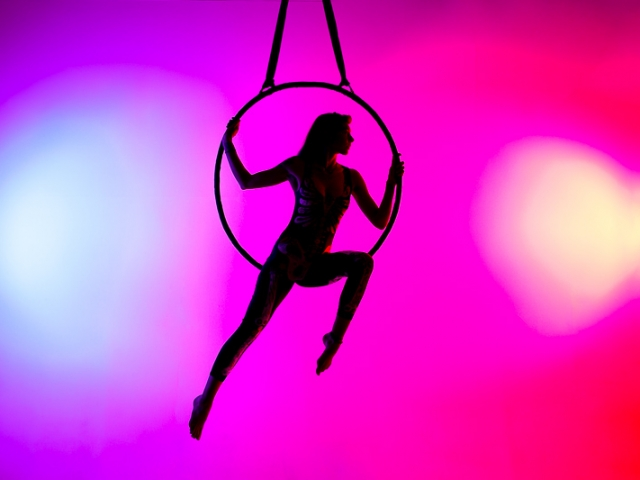 Aerial Hoop Silhouette with red and blue background