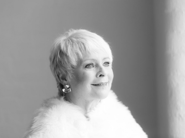 Glamorous black and white portrait with fur stole