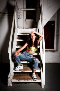 Spanish beauty in Urban fashion on stairs