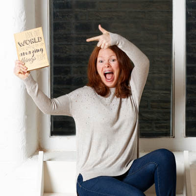 Awesome business woman portrait pointing at a book